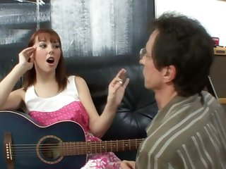 A sexy redhead teacher her guitar teacher to be a perfect pussy licker