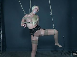 Mart slave Layla Love ball gagged, tied with respect to and distressful