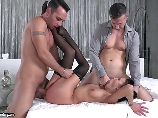 Slim brunette beauty spit roasted by a pair be fitting of big dicks