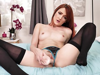 Redhead solo model Andi Barley-bree pleasures her cunt with a dildo