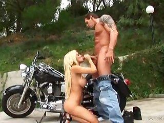 Hot busty biker girl Carmel Moore alfresco dealings
