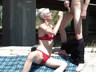 Still anticipating hot grey haired full-grown lady in red bikini gives BJ