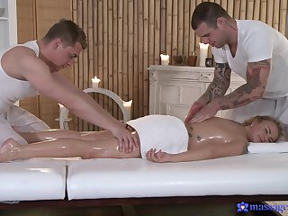 Magic threesome on the massage table for the oiled blonde