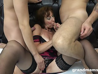 Old lady in sexy underwear sucks two big cocks increased by gets her cunt nailed