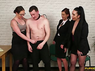 Naughty clothed babes enjoy pleasuring one dude's phony penis