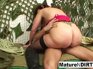 Mature officer fucks her new young recruit