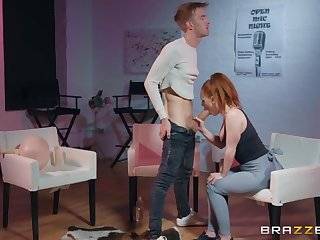 Super hot redhead takes a huge load of shit in torn yoga pants